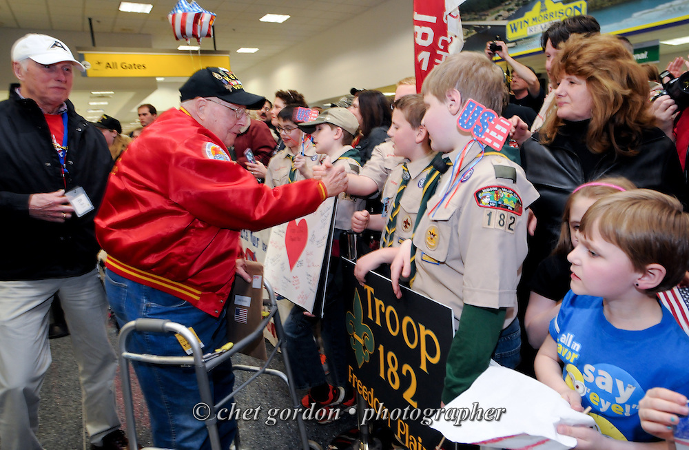 WWII Veterans and their escorts onboard the Hudson Valley Honor Flight arrive at Stewart International Airport in Newburgh, NY on Saturday, April 11, 2015. Nearly 100 Veterans from the Orange County (NY) region toured the WWII, Korean, Vietnam, and USMC War Memorials, as well as Arlington National Cemetery. Hudson Valley Honor Flight is a chapter of the Honor Flight Network, which provides free flights for WWII Veterans and tours of the WWII Memorial constructed in their honor, and other sites in the nation's capital.  © Chet Gordon for Hudson Valley Honor Flight