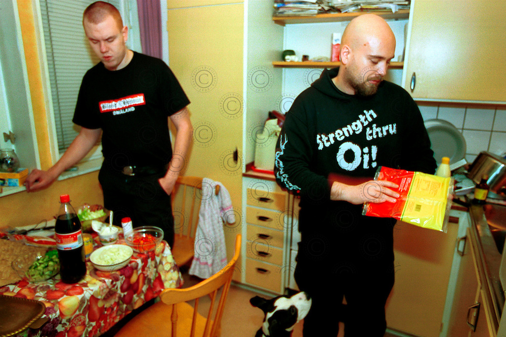 Two members of the extreme radical right Blood and Honour, prepares the evening meal..