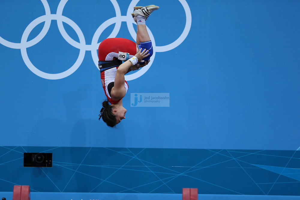 Begaj Romela of Albania does a back flip after failing to lift 121kg during the women's 58kg weightlifting event during day 3 of the London Olympic Games London, 30 Jul 2012..(Jed Jacobsohn/for The New York Times)....