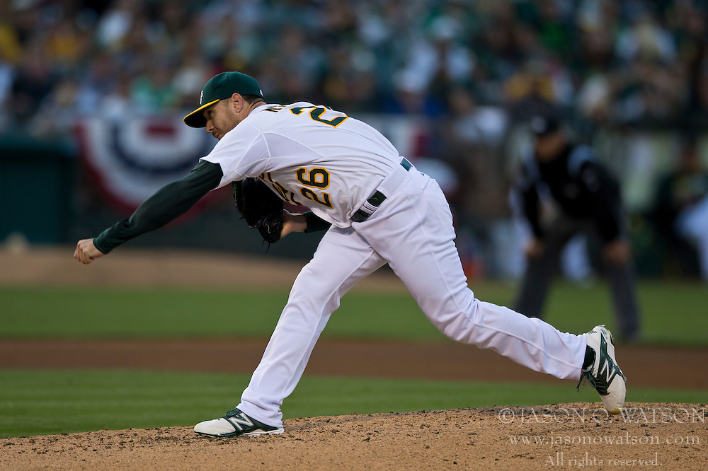 OAKLAND, CA - JULY 05:  Scott Kazmir #26 of the Oakland Athletics pitches against the Toronto Blue Jays during the fourth inning at O.co Coliseum on July 5, 2014 in Oakland, California. The Oakland Athletics defeated the Toronto Blue Jays 5-1.  (Photo by Jason O. Watson/Getty Images) *** Local Caption *** Scott Kazmir