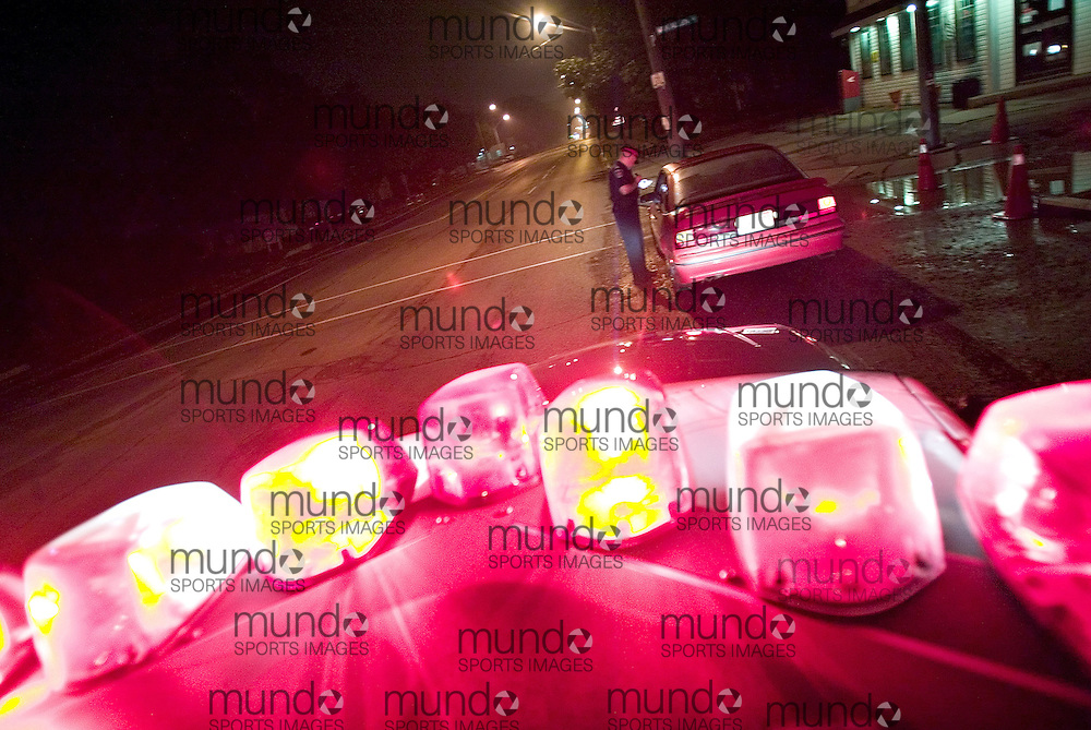 Chatham, Ontario ---06/7/27---  Constable Ed Rota makes a traffic stop at 2:20am on Grand Ave at Van Allen Ave. The driver had his license suspended for 12 hours..GEOFF ROBINS/ Chatham Daily News<br />