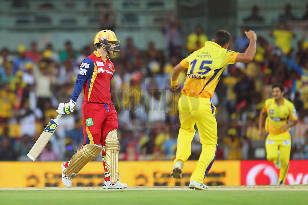 Ishwar Pandey of the Chennai Superkings celebrates the wicket of Nic Maddinson of the Royal Challengers Bangalore  during match 37 of the Pepsi IPL 2015 (Indian Premier League) between The Chennai Superkings and The Royal Challengers Bangalore held at the M. A. Chidambaram Stadium, Chennai Stadium in Chennai, India on the 4th May April 2015.<br /> <br /> Photo by:  Ron Gaunt / SPORTZPICS / IPL