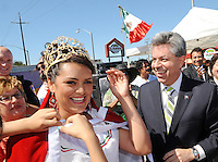 """Nally Gomez, 21, receives her crown as queen from Carlos Ponce Martinez, consul general of Mexico in San Jose, at Sunday's """"El Grito,"""" or """"The Cry of Independence"""" ceremony in Salinas."""