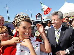 "Nally Gomez, 21, receives her crown as queen from Carlos Ponce Martinez, consul general of Mexico in San Jose, at Sunday's ""El Grito,"" or ""The Cry of Independence"" ceremony in Salinas."