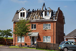 Pictured: A house in Redding near Falkirk is severely damaged ollowing a lightning strike during severe thunder and lightning storms that struck the central belt of Scotland overnight.   Andrew West/ EEm