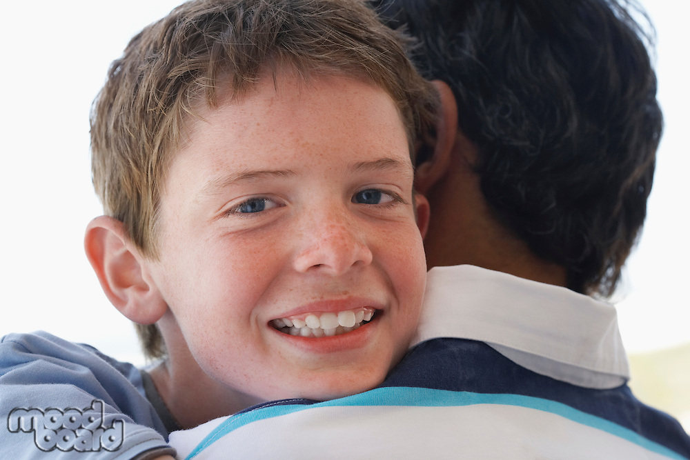 Close-up of Boy Hugging Father