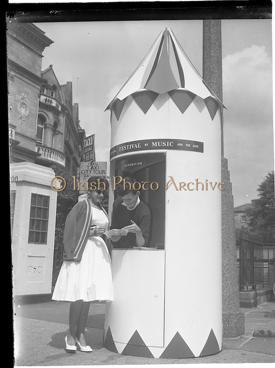 17/06/1960<br /> 06/17/1960<br /> 17 June 1960 <br /> Music Festival Kiosk. Picture shows Mrs Margaret Zaidan, Freetown, Sierra Leone, on honeymoon in Ireland, choosing festival events she wishes to attend ably assisted by Brian Mac Guigan at the International Festival of Music and the Arts Kiosk on College Street, Dublin.