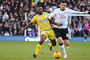 Sheffield Wednesday midfielder Jacques Maghoma (19) and Derby County midfielder George Thorne (34) during the Sky Bet Championship match between Derby County and Sheffield Wednesday at the iPro Stadium, Derby, England on 21 February 2015. Photo by Aaron Lupton.