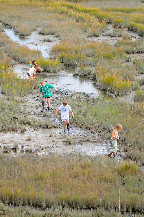 Young girls explore a marsh along the Rehobeth Bay in Delaware.