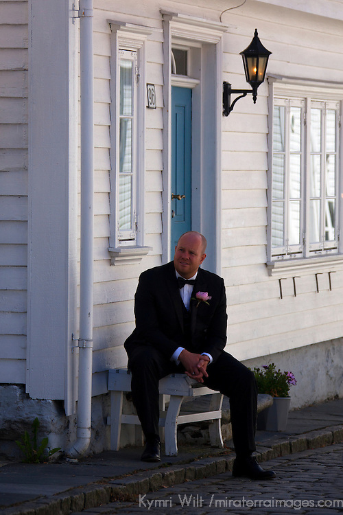 Europe, Norway, Stavanger. Norwegian Groom in Stqavanger watches his bride being photographed.