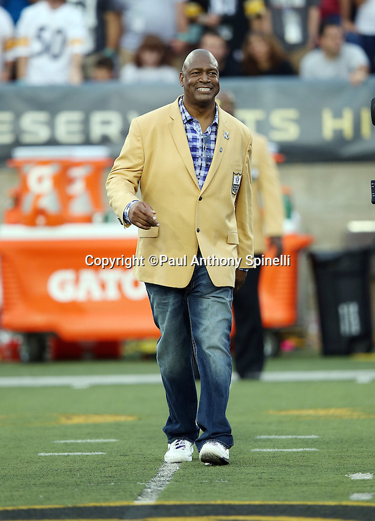 Former San Francisco 49ers and Dallas Cowboys defensive end Charles Haley is introduced as a newly enshrined member of the NFL Pro Football Hall of Fame before the Pittsburgh Steelers 2015 NFL Pro Football Hall of Fame preseason football game against the Minnesota Vikings on Sunday, Aug. 9, 2015 in Canton, Ohio. The Vikings won the game 14-3. (©Paul Anthony Spinelli)
