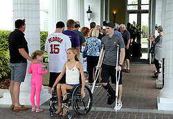 November 9, 2016 - New Port Richey, Florida, U.S. - DOUGLAS R. CLIFFORD   |   Times.Amanda Horner, of New Port Richey, center (wheelchair), and Mike Riccardi, of Trinity, leave the Heritage Springs Clubhouse in Trinity after Riccardi voted there on Tuesday (11/8/16) in Trinity. Lines at the popular precinct were constant throughout the day, with people waiting at times close to an hour to vote. (Credit Image: © Douglas R. Clifford/Tampa Bay Times via ZUMA Wire)