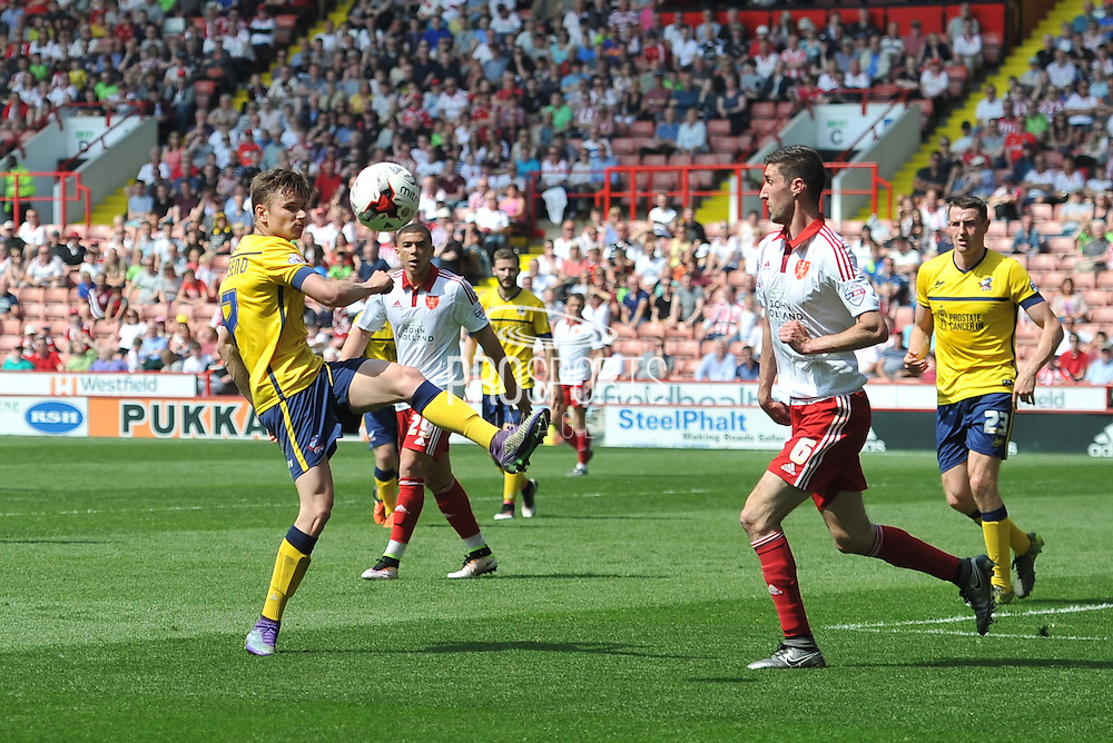 Conor Townsend of Scunthorpe United clears the ball from the goal area  during the Sky Bet League 1 match between Sheffield Utd and Scunthorpe United at Bramall Lane, Sheffield, England on 8 May 2016. Photo by Ian Lyall.