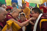 His Holiness the 14th Dalai Lama greets the local Abbot before he leads a prayer meeting at Sherboling Monastery, the day after Tibet Uprising Day.