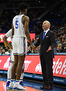 Nov 6, 2019; Los Angeles, CA, USA; UCLA Bruins head coach Mick Cronin talks with guard Chris Smith (5) in the second half against  Long Beach State at Pauley Pavilion. UCLA defeated Long Beach State 69-65 in Cronin's first game as UCLA coach.