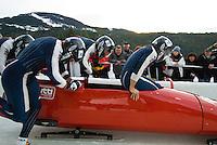 The Italian team of Simone Bertazzo, Gianluca Regjoli, Danilo Santarsiero, and Sergio Riva compete in the Mens' four-person bobsleigh World Cup competition held at the Whistler Sliding Centre on Feb 7, 2009