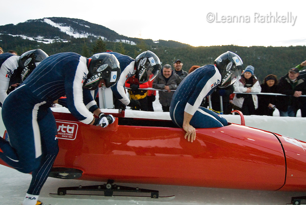 The Italian team of Simone Bertazzo, Gianluca Regjoli, Danilo Santarsiero, and Sergio Riva compete in the Mens' four-person bobsleigh World Cup competition held at the Whistler Sliding Centre on Feb 7, 2009