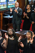 Democratic presidential hopeful Gov. Deval Patrick of Massachusetts, left, and LaJoia Broughton, right, join in the worship service at the historic Mother Emanuel AME Church January 1, 2020 in Charleston, South Carolina. The service celebrated Emancipation Day, marking the abolition of slavery in the United States.
