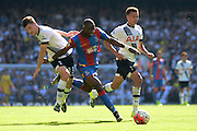 Ben Davies tries to stop Yannick Bolasie during the Barclays Premier League match between Tottenham Hotspur and Crystal Palace at White Hart Lane, London, England on 20 September 2015. Photo by Alan Franklin.