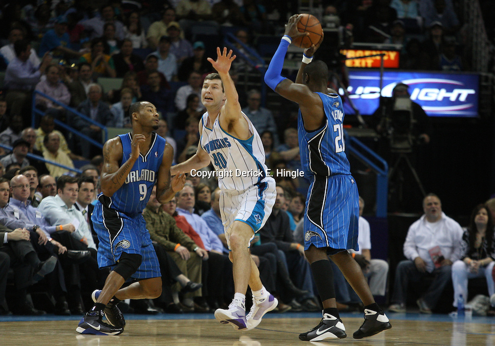 18 February 2009: Orlando Magic guard Mickael Pietrus (20) attempts to pass to forward Rashard Lewis (9) as New Orleans Hornets forward Ryan Bowen (40) defends the play during a 117-85 win by the New Orleans Hornets over the Orlando Magic at the New Orleans Arena in New Orleans, Louisiana.