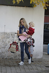 MADRID, SPAIN, 2015, NOVEMBER 06 Alejandra Silva, the girlfriend of Richard Gere, all a perfect mother with her son Albert. While waiting to be reunited with  Hollywood actor boyfriend. Dressed casually in skinny jeans, which marked his shapely figure, sports, white shirt and foulard.©Whitehotpix (Credit Image: © Whitehotpix via ZUMA Press)