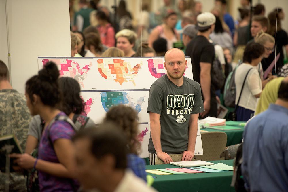 Matt McGill of Ohio University's Economics Department pauses between students during the 2016 Ohio University Majors Fair held at the Baker Center Ballroom on Wednesday, September 14, 2016.