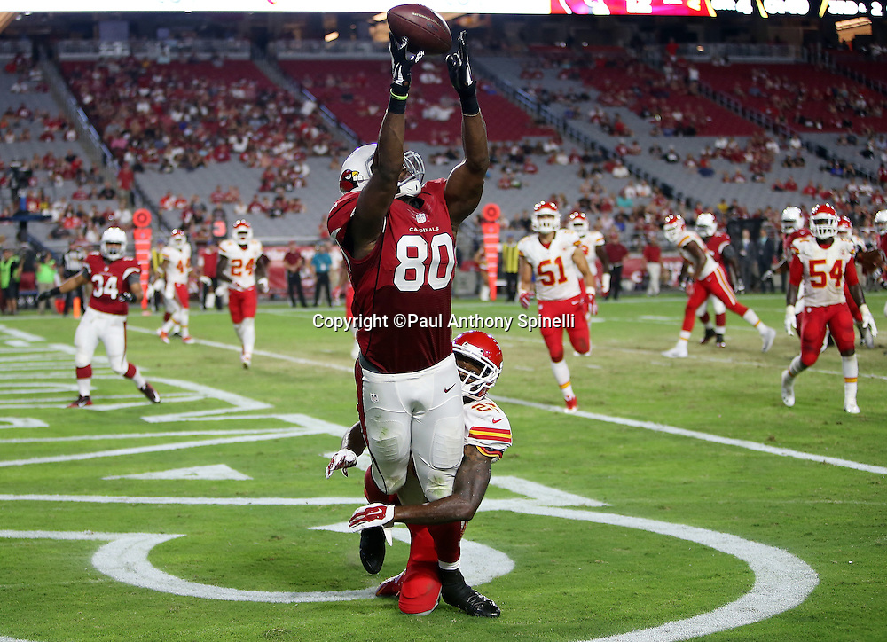 Arizona Cardinals tight end Ifeanyi Momah (80) is unable to catch an end zone pass because he was interfered with on the play by Kansas City Chiefs cornerback Sanders Commings (26) giving the Cardinals first and goal from the one yard line during the 2015 NFL preseason football game against the Kansas City Chiefs on Saturday, Aug. 15, 2015 in Glendale, Ariz. The Chiefs won the game 34-19. (©Paul Anthony Spinelli)