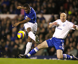 Liverpool, England - Wednesday, December 5, 2007: Everton's Victor Anichebe shoots under pressure from Zenit St. Petersburg's Erik Hagen during the UEFA Cup Group A match at Goodison Park. (Photo by David Rawcliffe/Propaganda)