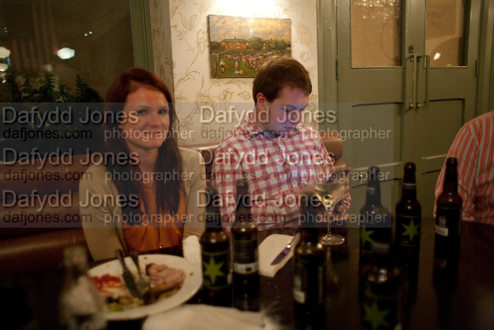 EMILY CONWAY; JOHN RUSSELL; WranglerÕs Nottinghill Carnival Party at the Bumpkin restaurant.  Westbourne Park Rd. London W1. 28 August 2011. <br /> <br />  , -DO NOT ARCHIVE-© Copyright Photograph by Dafydd Jones. 248 Clapham Rd. London SW9 0PZ. Tel 0207 820 0771. www.dafjones.com.<br /> EMILY CONWAY; JOHN RUSSELL; Wrangler's Nottinghill Carnival Party at the Bumpkin restaurant.  Westbourne Park Rd. London W1. 28 August 2011. <br /> <br />  , -DO NOT ARCHIVE-© Copyright Photograph by Dafydd Jones. 248 Clapham Rd. London SW9 0PZ. Tel 0207 820 0771. www.dafjones.com.