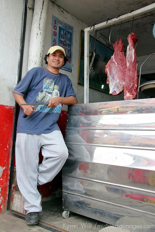 South America, Ecuador, Calderon. Meat vendor in Calderon, a small Andean town outside of Quito.