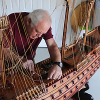 Michael Demonte works on a model ship at his home in Leland. (Jason A. Frizzelle)