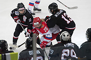 Russia forward Dobrodeyeva Ekaterina fights for the puck in the third period during the Nagano Olympics Paralympics 20th Anniversary Games at Nagano on Monday, December 25, 2017. 25/12/2017-Nagano, JAPAN.