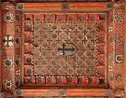 Ceiling of the Upper Hermitage of the Santuario de la Virgen de la Fuente, or Sanctuary of the Virgin of the Fountain, showing mudejar wooden panelling, Penarroya de Tastavins, Matarrana, Teruel, Aragon, Spain. In the 13th century, an image of the Virgin Mary was discovered beside a spring in this spot, and a chapel was built, which was replaced in the 14th century by a Gothic building. The Upper Hermitage was begun in 1341 in Aragonese Gothic style. It has one nave in 5 sections with a wooden roof decorated in mudejar style, with Calatrava crosses and heraldic symbols. The hermitage was declared a Spanish National Monument in 1941 and a UNESCO World Heritage Site in 2001 under the Mudejar Art bracket. Picture by Manuel Cohen