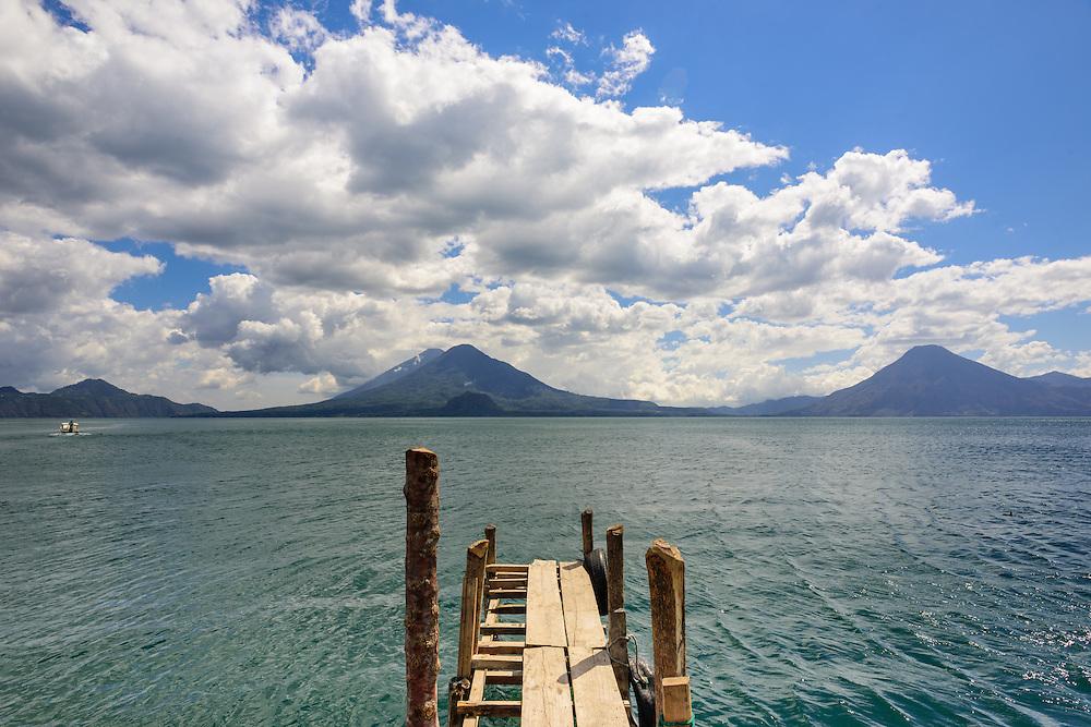 Boatdock into Lago Atitlan with on the background two volcanoes, Lago Atitlan, Guatemala.