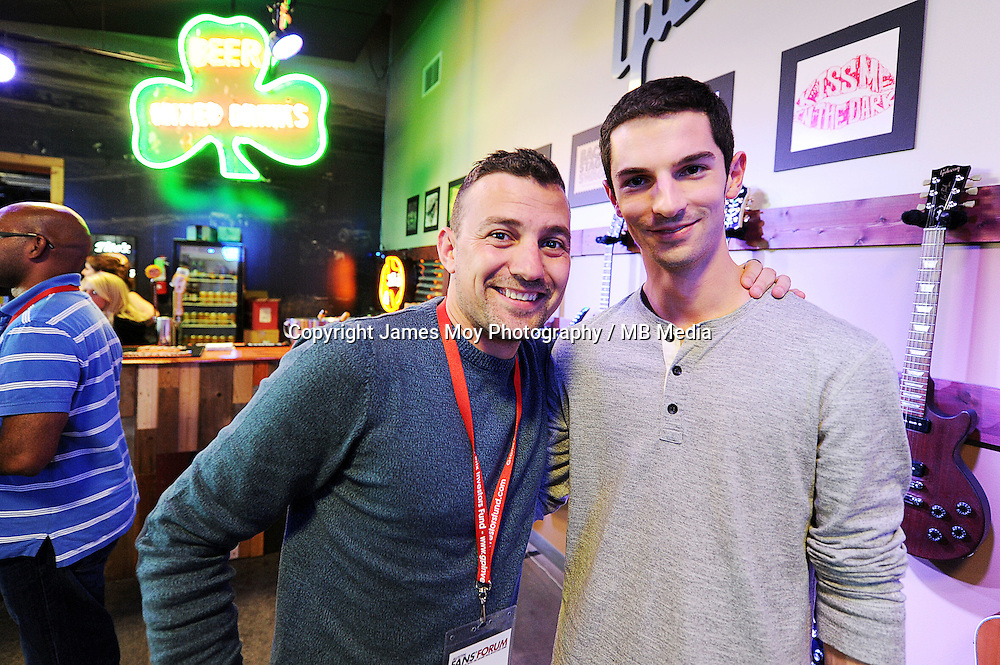 (L to R): Will Buxton (GBR) NBS Sports Network TV Presenter with Alexander Rossi (USA) Marussia F1 Team Reserve Driver at the Fans' Forum.<br /> United States Grand Prix, Wednesday 29th October 2014. Circuit of the Americas, Austin, Texas, USA.