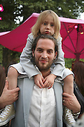 SANDRO KOPP AND VALENTIN PINOTEAU,( CHILD)  The Summer Party sponsored by Yves St. Laurent. Serpentine Gallery. 11 July 2006. . ONE TIME USE ONLY - DO NOT ARCHIVE  © Copyright Photograph by Dafydd Jones 66 Stockwell Park Rd. London SW9 0DA Tel 020 7733 0108 www.dafjones.com