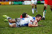Keighley Cougars scrum half Matty Beharrell (7) can't stop Workington Town hooker Sean Penkywicz (24) scores a try  during the Betfred League 1 match between Keighley Cougars and Workington Town at Cougar Park, Keighley, United Kingdom on 18 February 2018. Picture by Simon Davies.