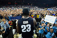 04 APR 2016: Forward Daniel Ochefu (23) of Villanova University embraces the band and fans following their win over the University of North Carolina during the 2016 NCAA Men's Division I Basketball Final Four Championship game held at NRG Stadium in Houston, TX.  Villanova defeated North Carolina 77-74 to win the national title. Brett Wilhelm/NCAA Photos
