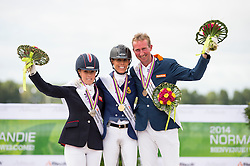 Podium individual test grade IV 1. Michel George and FBW Rainman, 2. Sophie Wells and Valerus, 3. Frank Hosmar and Alphaville NOP - Individual Test Grade IV Para Dressage - Alltech FEI World Equestrian Games™ 2014 - Normandy, France.<br /> © Hippo Foto Team - Jon Stroud <br /> 25/06/14