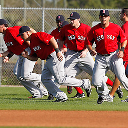 February 18, 2011; Fort Myers, FL, USA; Boston Red Sox catchers work out during spring training at the Player Development Complex.  Mandatory Credit: Derick E. Hingle