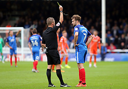 Gwion Edwards of Peterborough United is shown a yellow card by the match referee - Mandatory by-line: Joe Dent/JMP - 28/10/2017 - FOOTBALL - ABAX Stadium - Peterborough, England - Peterborough United v Shrewsbury Town - Sky Bet League One