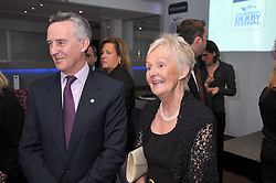 Trainer JIM BOLGER and his wife JACKIE at the launch of the 2009 Derby Festival in the presence of HRH Princess Haya of Jordan in aid of the charity Starlight held at the Kensington Roof Gardens, 99 Kensington High Street, London W8 on 12th May 2009.