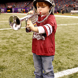 December 18, 2010; New Orleans, LA, USA; A young Troy Trojans fan plays a toy trumpet following a win over the Ohio Bobcats in the 2010 New Orleans Bowl at the Louisiana Superdome. Troy defeated Ohio 48-21. Mandatory Credit: Derick E. Hingle
