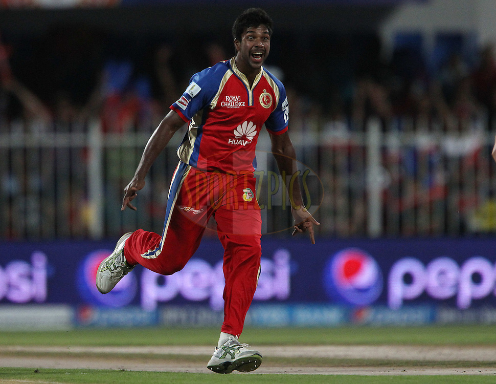 Varun Aaron of the Royal Challengers Bangalore celebrates the wicket of Manoj Tiwary of the Delhi Daredevils during match 2 of the Pepsi Indian Premier League Season 7 between the Delhi Daredevils and The Royal Challengers Bangalore held at the Sharjah Cricket Stadium, Sharjah, United Arab Emirates on the 17th April 2014<br /> <br /> Photo by Ron Gaunt / IPL / SPORTZPICS
