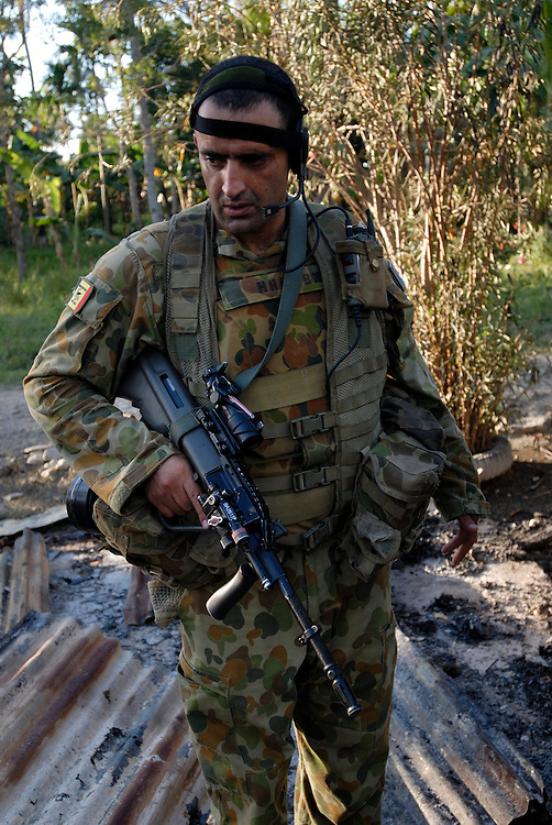 Australian Peace Keepers patrol Bairo Pitie, an area in Dili norious for gang violence and arson.