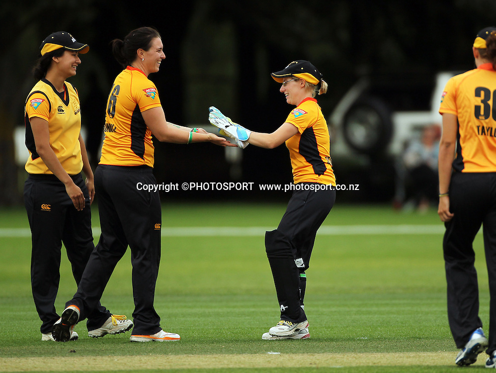Michelle Bunkall is congratulated by Andrea Stockwell for Wellington. Canterbury Magicians v Wellington Blaze. Action Cricket Twenty20, womens cricket match, Lincoln No. 3, Lincoln University, Thursday 29 December 2011. Photo : Joseph Johnson / photosport.co.nz