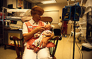Partners Health Plan, Premie Cuddler Program, Nell Clevenger holds babies at Tucson Medical Center.©1993 Edward McCain. All rights reserved. McCain Photography, McCain Creative, Inc.