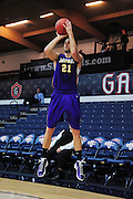 November 28, 2011; Moraga, CA, USA; San Francisco State Gators forward Griffin Reilly (21) shoots the ball during the first half of the Shamrock Office Solutions Classic consolation game against the Jacksonville State Gamecocks at McKeon Pavilion. The Gators defeated the Gamecocks 71-68.