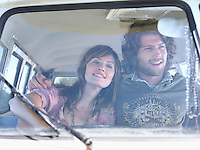 Couple Sitting in camper van view through windscreen