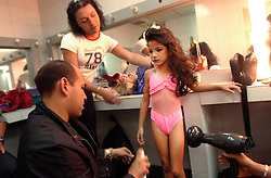 Elianna Lanz gets her makeup and hair done during the Miss Mini Universe competition for children ages 6-10.  Venezuela has a deep culture of beauty, fashion and sex appeal. There are dozens of beauty pageants throughout the year for boys and girls of all ages..